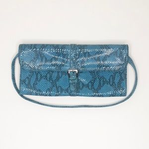 Bebe snakeskin leather clutch